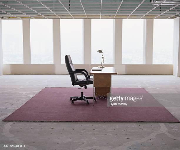 Desk in empty office space