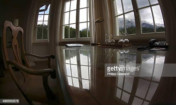 Desk is seen in a suite at Schloss Elmau, a luxury spa hotel, in the Bavarian Alps of southern Germany on June 3, 2014 in Kruen near...