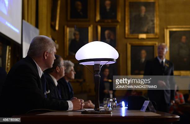 A desk lamp and an LED torch light are seen on the desk as Nobel Committee for Physics member Olle Inganas and Nobel Committee for Physics chairman...