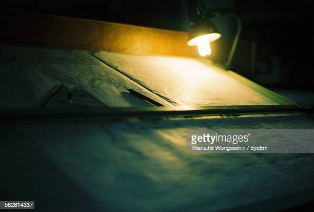 Desk Lamp And Pad Of Paper With Pencil