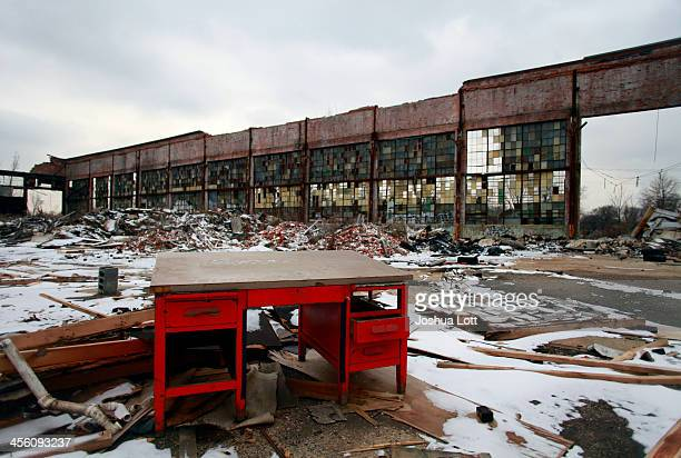 A desk remains at the abandoned Packard Automotive Plant December 13 2013 in Detroit Michigan Perubased developer Fernando Palazuelo made his final...