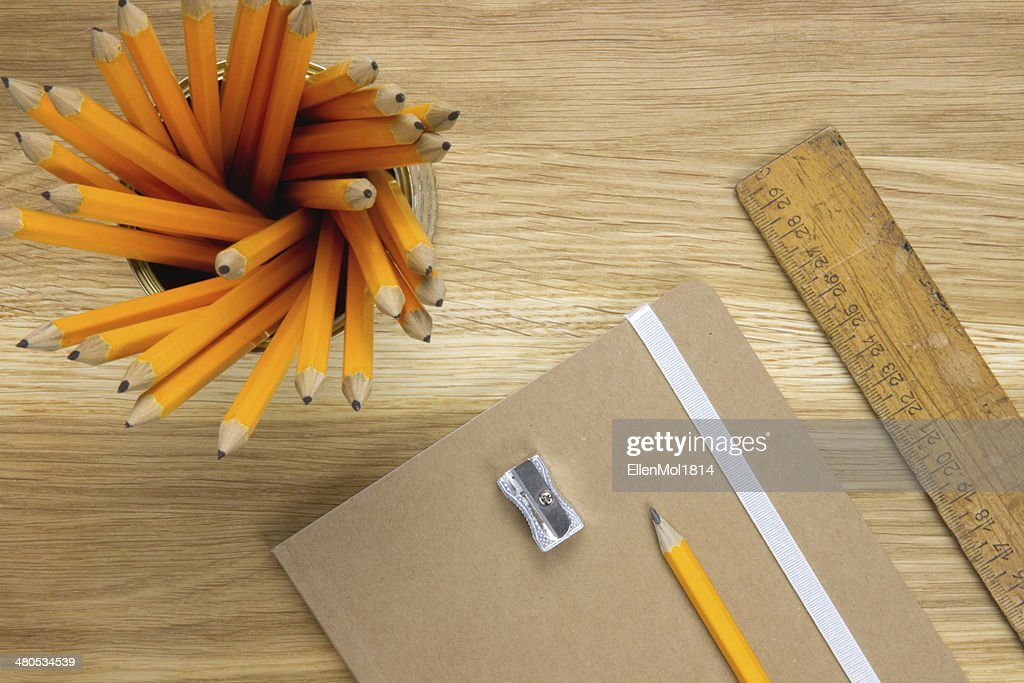 desk supplies on wooden desktop : Stock Photo