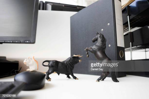 desk toys representing different personalities in the workplace - desk toy stock photos and pictures