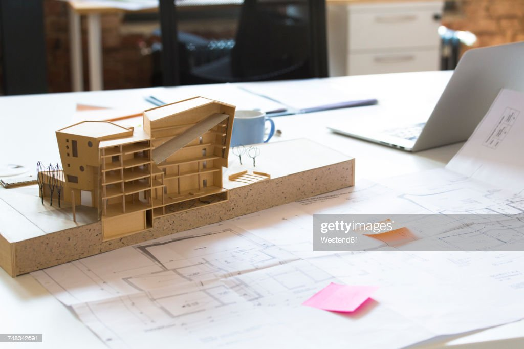 Desk with architectural model : Stock Photo