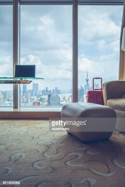 desk with laptop in front of shanghai city skyline