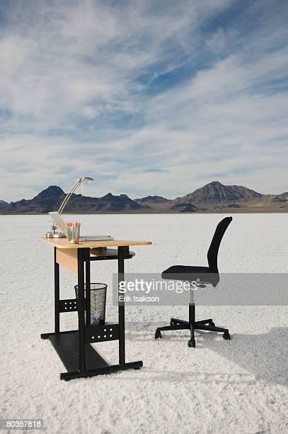 Desk with laptop on salt flats, Salt Flats, Utah, United States