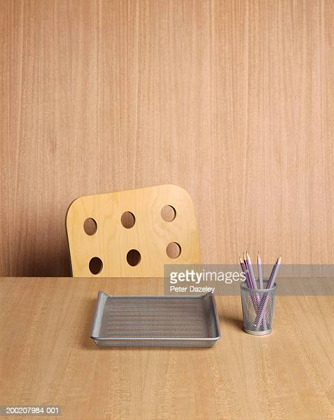 Desk with pencil container and empty in-tray