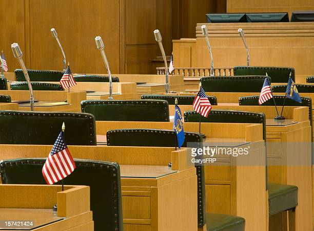 desks with flags and microphones for oregon house of representatives - house of representatives stock pictures, royalty-free photos & images