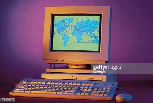 Desktop computer with graphics displaying the world
