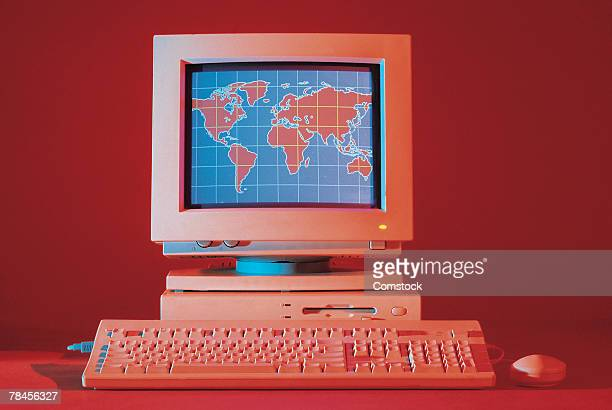 Desktop computer with world map on monitor