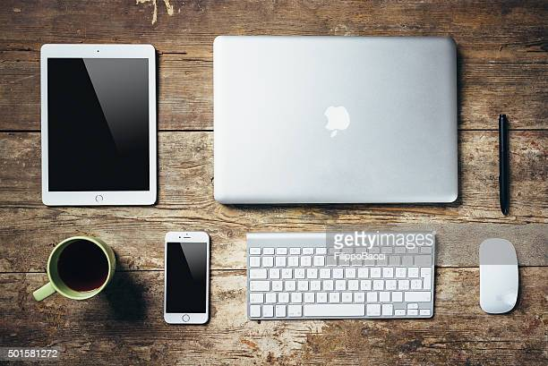Desktop Essentials On Wooden Table
