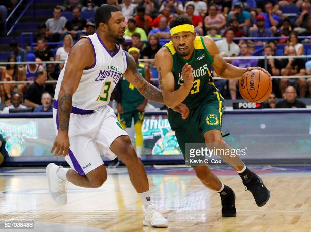 Desmon Farmer of the Ball Hogs drives the basket while being guarded by Eddie Basden of the 3 Headed Monsters during week seven of the BIG3 three on...