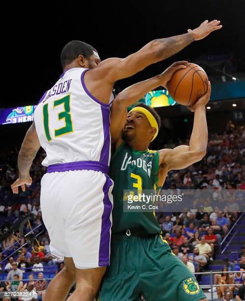 Desmon Farmer of the Ball Hogs is guarded by Eddie Basden of the 3 Headed Monsters as he drives the basket during week seven of the BIG3 three on...