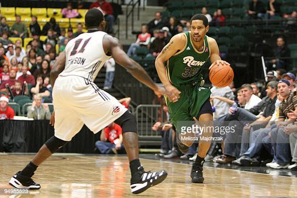 Desmon Farmer of the Reno Bighorns drives the ball against Dontell Jefferson of the Utah Flash during the D-League game on December 11, 2009 at the...