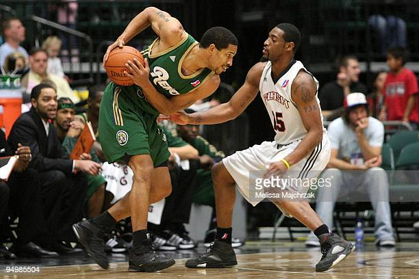 Desmon Farmer of the Reno Bighorns drives the ball against Orien Greene of the Utah Flash during the D-League game on December 11, 2009 at the McKay...