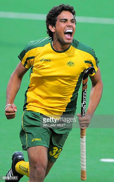 Desmond Abbott of Australia celebrates scoring the winning goal against England during their Champions Trophy field hockey match in Melbourne on...