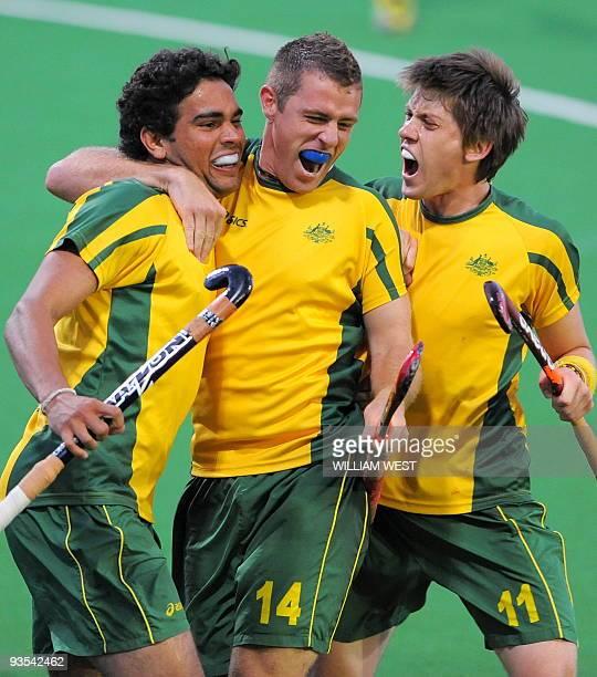Desmond Abbott of Australia is congratulated by teammates Grant Schubert and Edward Ockenden after scoring the winning goal against England during...