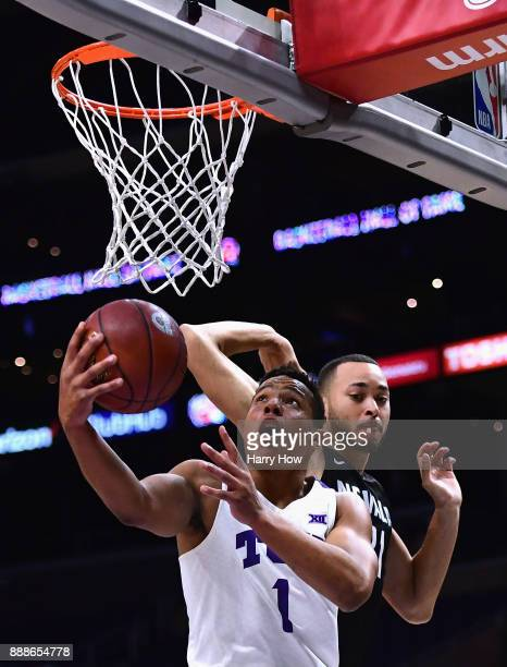 Desmond Bane of the TCU Horned Frogs attempts a layup on Kendall Stephens of the Nevada Wolf Pack during the Basketball Hall of Fame Classic at...