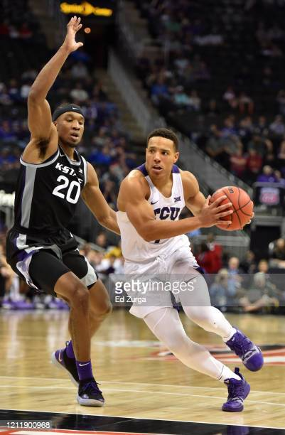 Desmond Bane of the TCU Horned Frogs drives to the basket against Xavier Sneed of the Kansas State Wildcats in the second half during the first round...