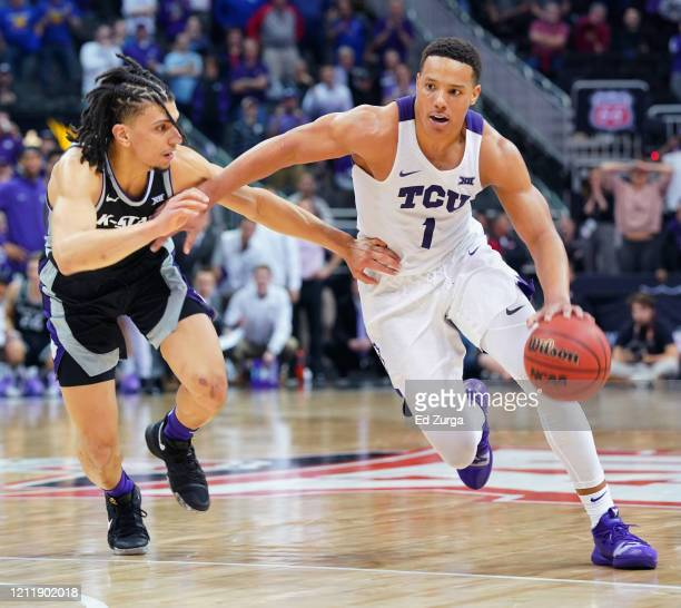 Desmond Bane of the TCU Horned Frogs drives to the basket against Mike McGuirl of the Kansas State Wildcats in the second half during the first round...