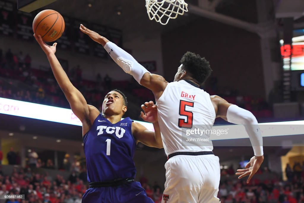 Desmond Bane #1 of the TCU Horned Frogs goes to the basket against Justin Gray #5 of the Texas Tech Red Raiders during the second half of the game on March 3, 2018 at United Supermarket Arena in Lubbock, Texas. Texas Tech defeated TCU