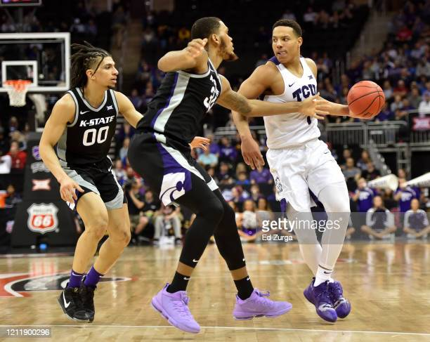 Desmond Bane of the TCU Horned Frogs is defended by Mike McGuirl and Levi Stockard III of the Kansas State Wildcats in the second half during the...