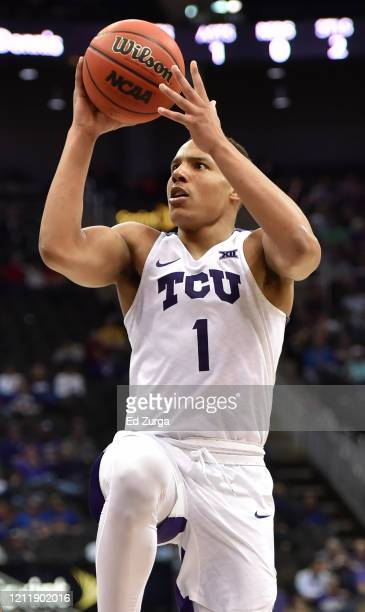 Desmond Bane of the TCU Horned Frogs lays the ball up against the Kansas State Wildcats in the second half during the first round of the Big 12...