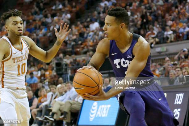 Desmond Bane of the TCU Horned Frogs passes around Eric Davis Jr #10 of the Texas Longhorns at the Frank Erwin Center on January 10 2018 in Austin...