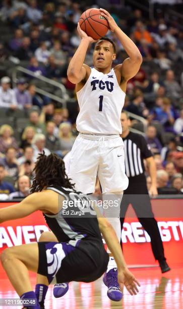 Desmond Bane of the TCU Horned Frogs shoots over Mike McGuirl of the Kansas State Wildcats in the second half during the first round of the Big 12...