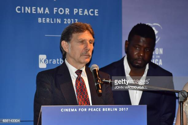 Desmond Doss Junior son of the Hacksaw Ridge movie character soldier Desmond Doss adresses guests after winning the award at the Cinema For Peace in...