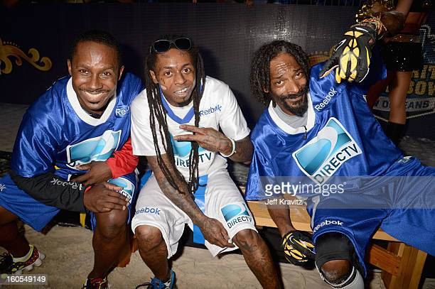 Desmond Howard Lil Wayne and Snoop Dogg attend DIRECTV'S 7th Annual Celebrity Beach Bowl at DTV SuperFan Stadium at Mardi Gras World on February 2...
