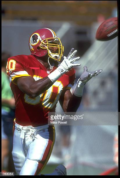Desmond Howard of the Washington Redskins catches a pass during the game against the Phoenix Cardinal at Sun Devil Stadium in Tempe Arizona October 4...