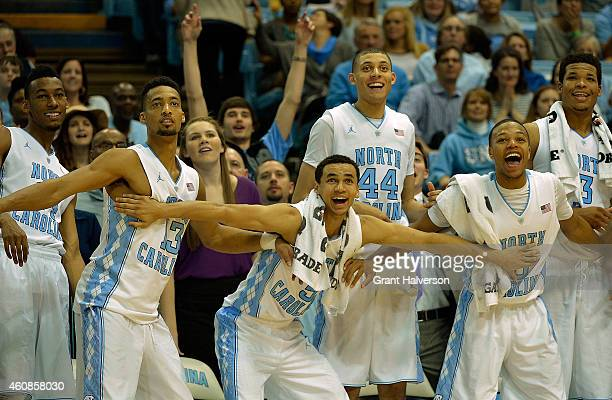 Desmond Hubert, J.P. Tokoto, Marcus Paige, Justin Jackson, Nate Britt and Kennedy Meeks of the North Carolina Tar Heels cheer on the reserves during...