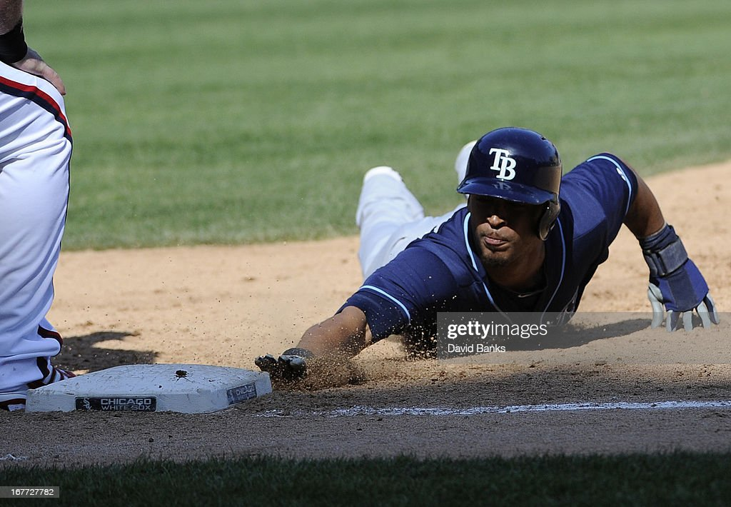 Desmond Jennings #8 of the Tampa Bay Rays dives into first base against the Chicago White Sox during the ninth inning on April 28, 2013 at U.S. Cellular Field in Chicago, Illinois. TheTampa Bay Rays defeated the Chicago White Sox 8-3.