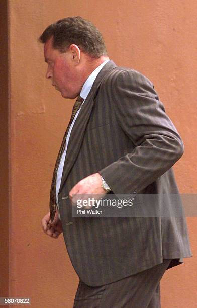 Desmond John Millward runs into a cafe trying to hide from the photographer near the Auckland District Court where he is facing charges of...