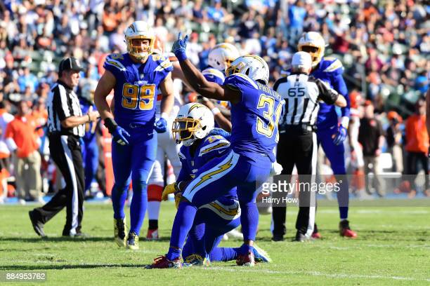 Desmond King and Adrian Phillips of the Los Angeles Chargers celebrate a sack during the second quarter of the game against the Cleveland Browns at...