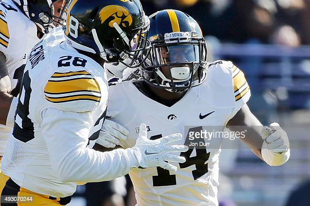 Desmond King of the Iowa Hawkeyes celebrates with Maurice Fleming after making an interception against the Northwestern Wildcats during the first...