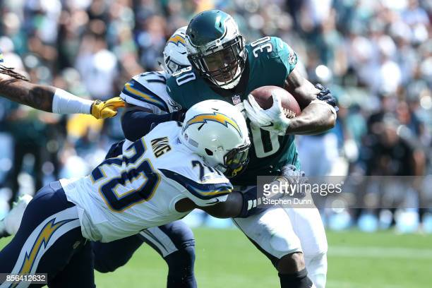 Desmond King of the Los Angeles Chargers attempts to tackle Corey Clement of the Philadelphia Eagles during the first half at StubHub Center on...