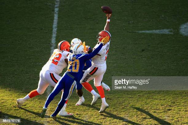 Desmond King of the Los Angeles Chargers pressures DeShone Kizer of the Cleveland Browns during the second half of a game at StubHub Center on...