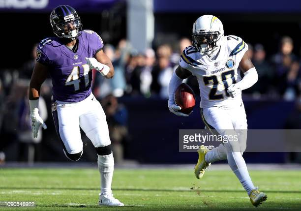Desmond King of the Los Angeles Chargers returns the ball against the Baltimore Ravens during the first quarter in the AFC Wild Card Playoff game at...