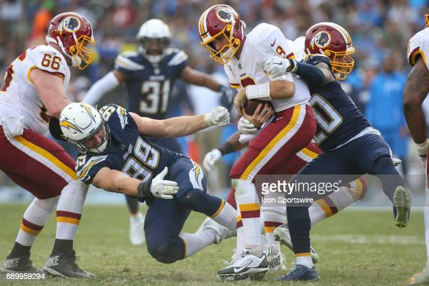 Desmond King of the Los Angeles Chargers sacks Kirk Cousins of the Washington Redskins during a NFL game between the Washington Redskins and the Los...