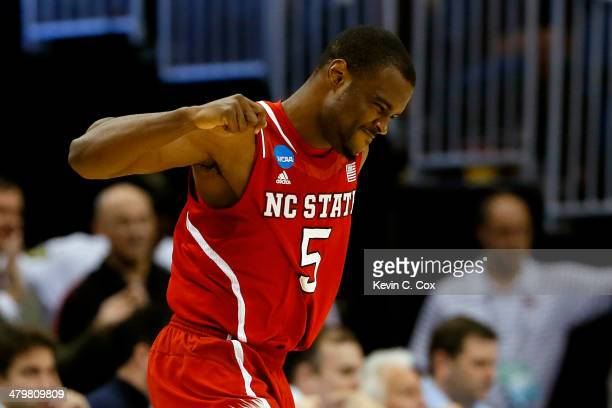 Desmond Lee of the North Carolina State Wolfpack celebrates a three point basket in the second half against the Saint Louis Billikens during the...