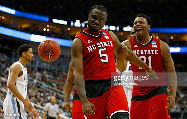 Desmond Lee of the North Carolina State Wolfpack celebrates after making a shot and getting fouled with teammate Beejay Anya during the second half...
