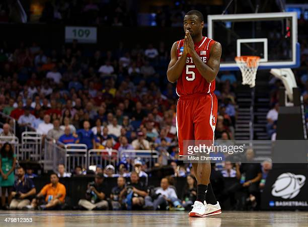 Desmond Lee of the North Carolina State Wolfpack reacts in the second half against the Saint Louis Billikens during the second round of the 2014 NCAA...