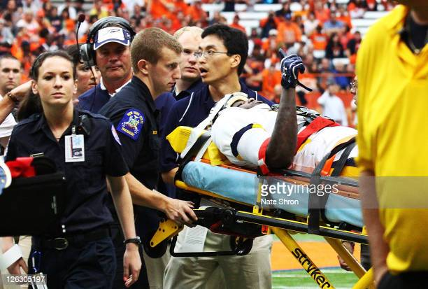 Desmond Marrow of the Toledo Rockets gives a thumbs up to the crowd as he is taken off the field on a stretcher after an injury in the game against...