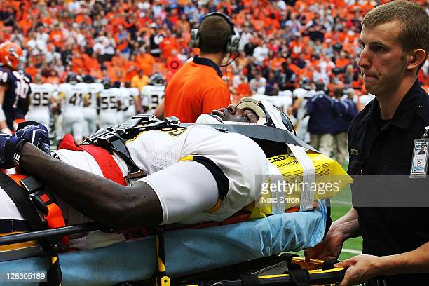 Desmond Marrow of the Toledo Rockets is taken off the field on a stretcher after an injury in the game against the Syracuse Orange on September 24,...