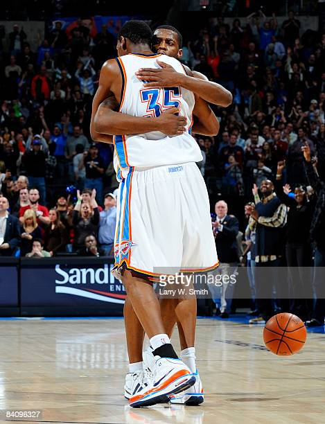 Desmond Mason and Kevin Durant of the Oklahoma City Thunder hug each other after winning the game against the Toronto Raptors at the Ford Center on...