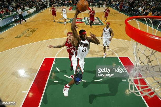 Desmond Mason of the Milwaukee Bucks attempts a dunk and is fouled by Delonte West of the Cleveland Cavaliers at the Bradley Center March 22 2008 in...