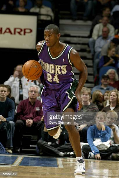 Desmond Mason of the Milwaukee Bucks brings the ball upcourt during the preseason game against the Minnesota Timberwolves on October 12 2005 at the...