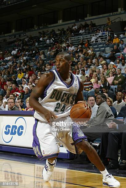 Desmond Mason of the Milwaukee Bucks drives against the Dallas Mavericks during the preseason game at Bradley Center on October 23 2004 in Milwaukee...